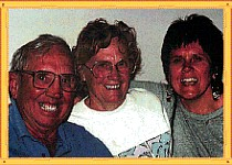 Sandi and her parents 1995